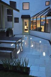 In ground slot lighting set into paving