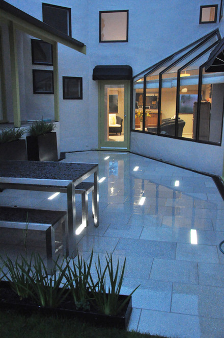 In ground slot lighting set into paving