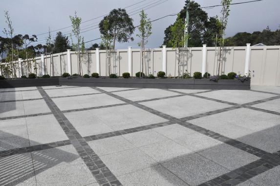 Courtyard/driveway design by Mosaic Design