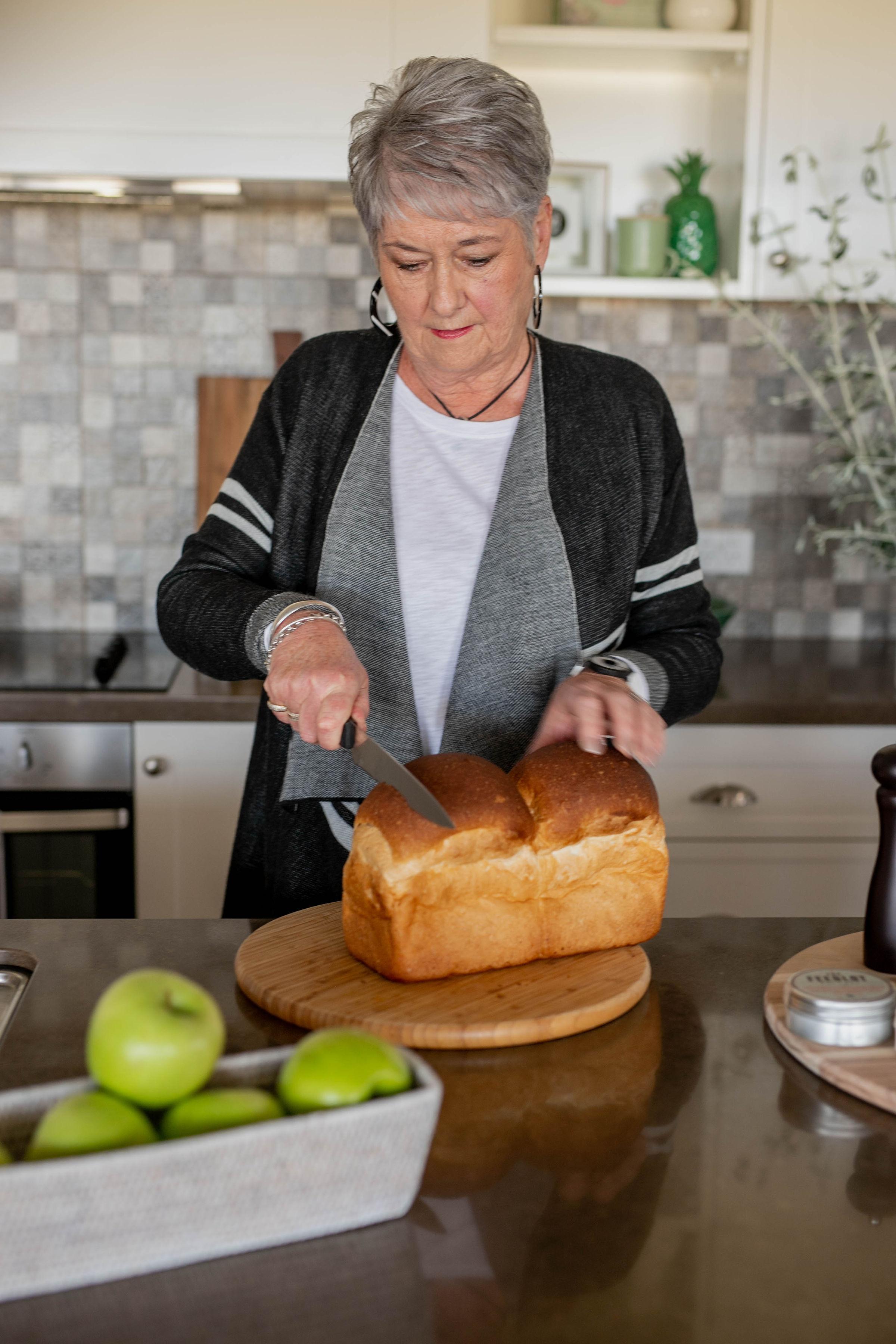 Shirley cutting bread