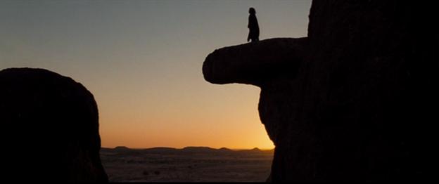 Rising Sun Man on Phalic cliff.png