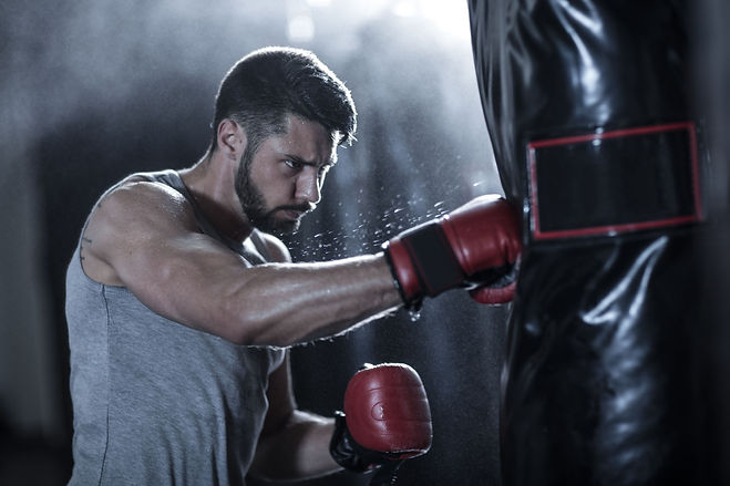 boxer-exercising-with-punch-bag-royalty-