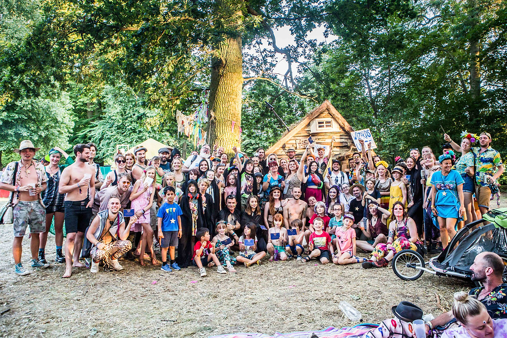 A large group of people posing outside the Wizards Shack