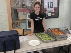 Jordan serving meals at Rookies Camp.jpg