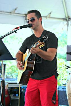 Scott Elk performing at Manzopalooza