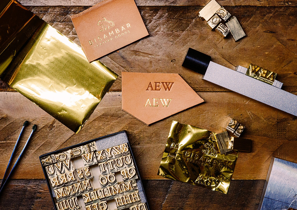 Embossing with gold foil as well as blind embossing on vegetable-tanned natural leather