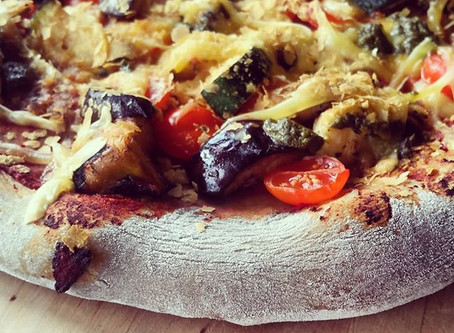 Charcoal Sourdough Pizza: Aubergine, Courgette,Smoke House Cheese, Olive.