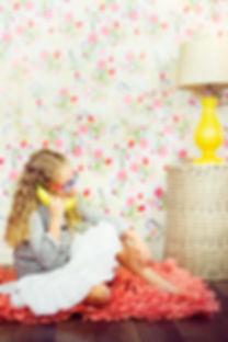 Girl talking on a pretend phone.jpg