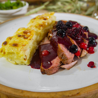 Duck breast with Dauphinois Potatoes and a Verjuice Red Berry Reduction