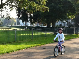 Child cycling in Victoria Park