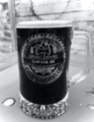 Founders Pounder mug filled with Spar Tree Oatmeal Stout