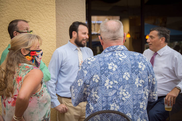 Jared speaking with voters