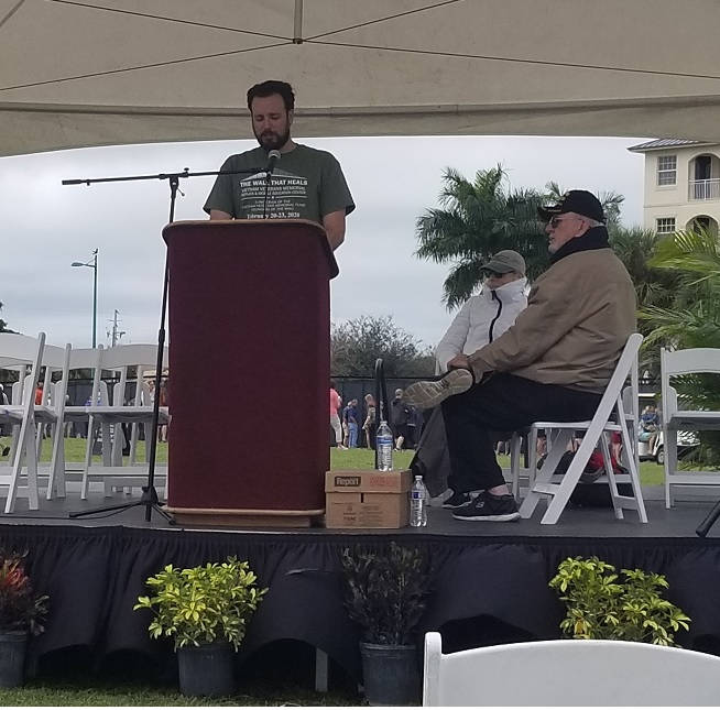 Jared reading in remembrance the names of some of our Florida veterans who were killed in action in Vietnam at the Wall that Heals.