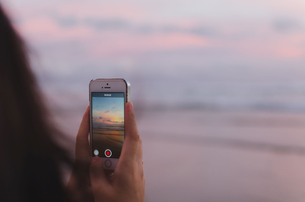 woman taking video with a mobile phone