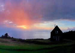 SeaSky cottage on moody evening