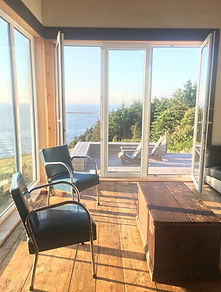living room, with door to deck, seasky cottgages in chimney corner, cape breton