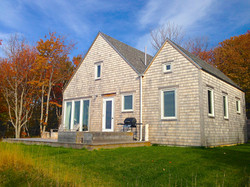 cape cottage in Fall, chimney corner