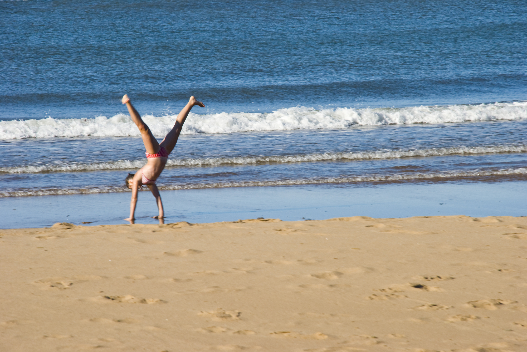 handstand at beach, chimney corner