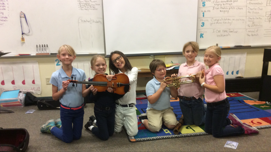 Students with instruments from Future Arts Foundation