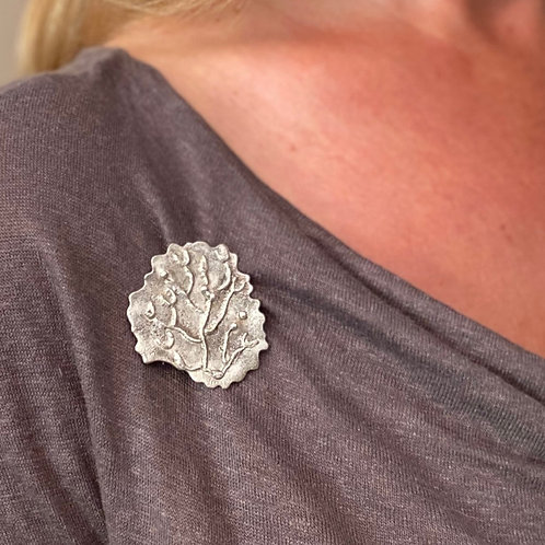 Cladonia sterling silver brooch being worn