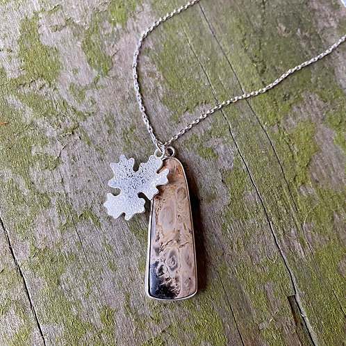 Fossilised palm root pendant, front view