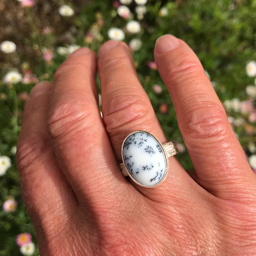 Dendritic agate and sterling silver ring shown being worn