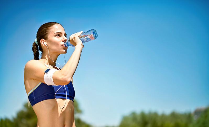 fit-woman-drinking-water.jpg