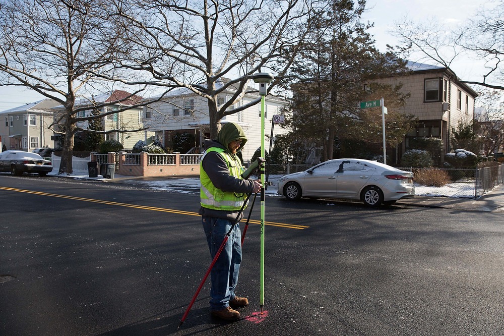 Joseph Davidson, a survey technician, outside the home of George and Laura Fishman in the Canarsie section of Brooklyn. Credit Kevin Hagen for The New York Times