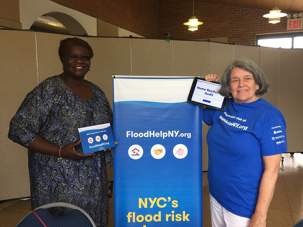 7/29/17 State Senator Roxanne Persaud and NHS Brooklyn Program Manager, Elizabeth Malone promoting Home Resiliency Audits at Sen. Persaud's Rain Barrel Giveaway in Bergen Beach