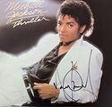 Michael Jackson signed Thriller, bid online, todd mueller autographs, madonna signature