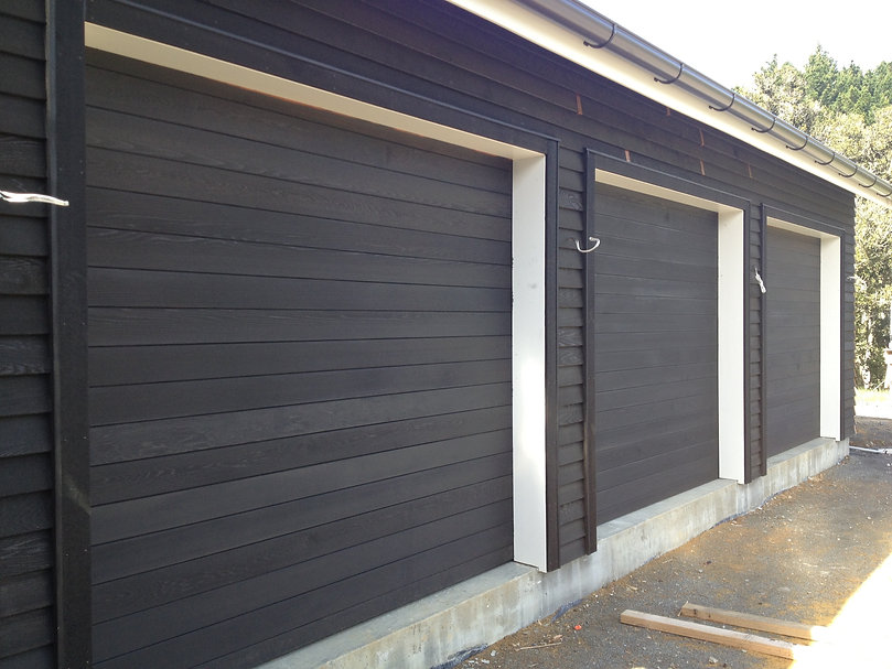 Auckland Garage Doors, I want to have a new door installed, budget garage, how much cost for a new garage door, new remote control system, garage door installation in Auckland