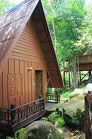 Bungalow and tent camping accommodation at Picnic Resort, Sihanoukville, Cambodia