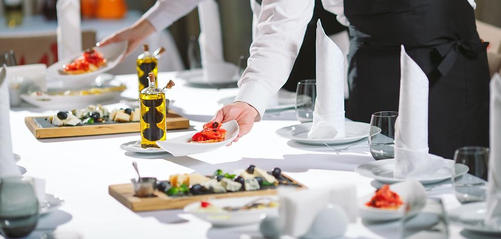 waiter-serving-table-restaurant-preparin