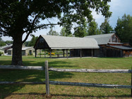 The Barn Chapel, and beyond it, the Visitors' Center, in summer