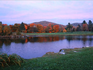 The mountains and front pond, in autumn, at twilight