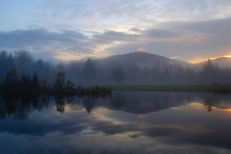 Weston Priory front pond and mountain at sunrise in autumn