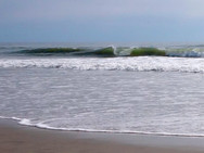 A breaking wave amidst the surf