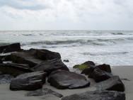 Stone breakers along the seashore
