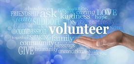 Volunteers needed hand gesture on blue b