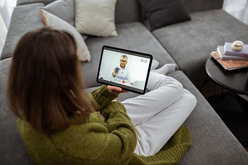 Woman talking with a doctor online using
