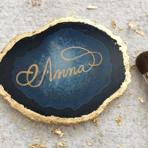 Agate slice place card trimmed in gold leaf.