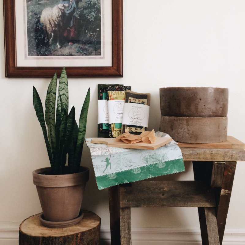 beeswax pucks sitting beside eco friendly beeyond the hive wraps