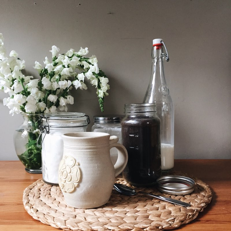 reusable glass jars filled with coffee, sugar, and milk