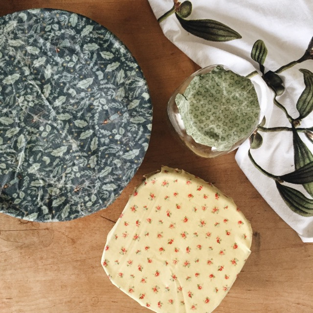 reusable beeswax wraps covering bowls and jars
