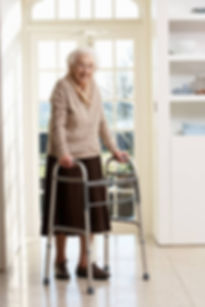 senior lady with walker entering her kitchen