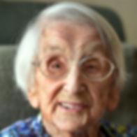 smiling senior lady at home