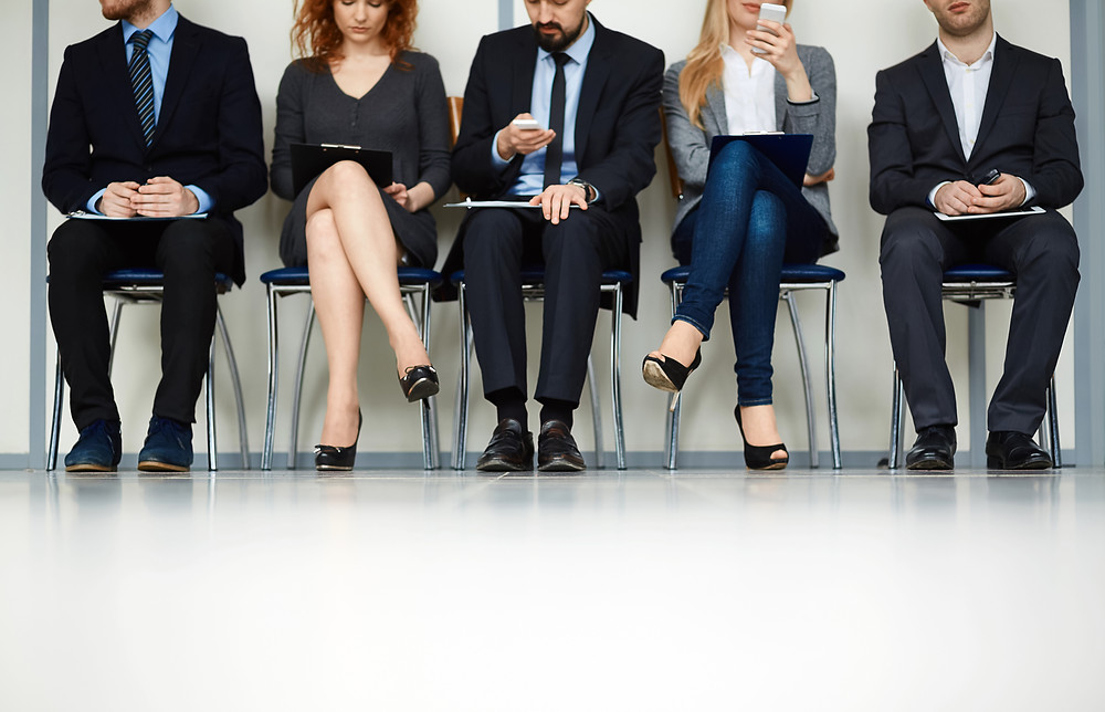 Business Professionals sitting and waiting for an interview