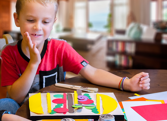 Proud boy looking at his Matisse inspired Dagwood sandwich masterpiece from Paper Cutouts and Cartoon Art Kit 'n' Kaboodle