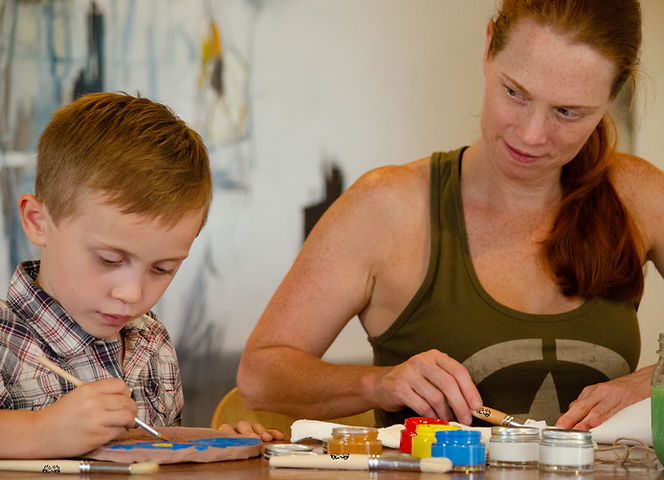 Mom and son enjoying benefits of art and recharging with electronic-free time while painting natural air-dry clay masterpiece