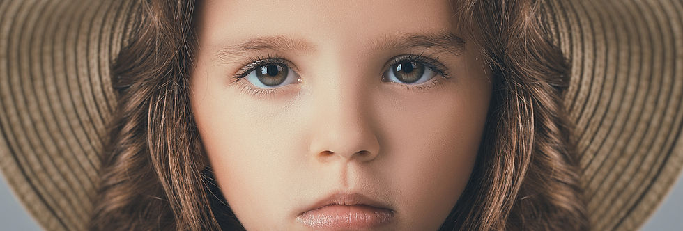 A close up of an unsmiling girl's face to inspire creativity.